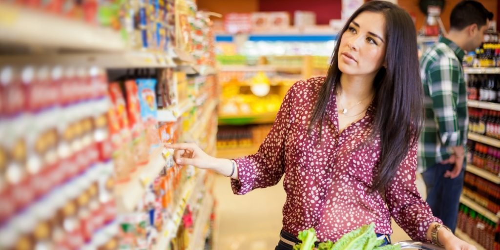 Woman Shopping in Grocery Store Consumer Promotion Strategies
