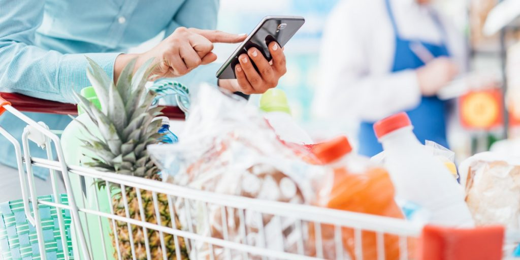 Person Shopping in Grocery Store on Phone